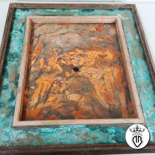 tela rivestita in ferro ossidata.cornice in bronzo e ossidazione blu